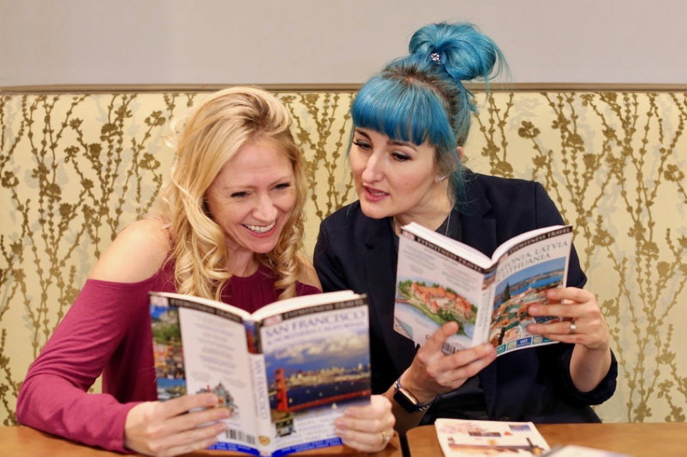 Julie and Katie looking at guide books