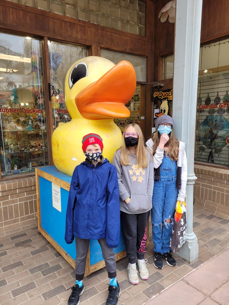 Kids standing in front of Manitou ducks.